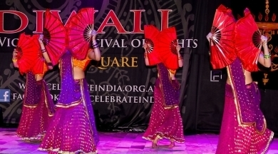 Diw2 Ignite Bollywood Dancers with red fans at Diwali