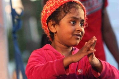 St Kilda Festival little girl watches Bollywood dance