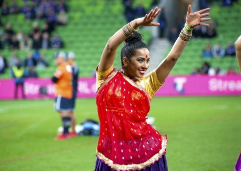 Smiling Bollywood dancer at AAMI Park